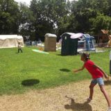 Playing frisbee at summer camp.