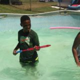 Playing in the pool this summer.