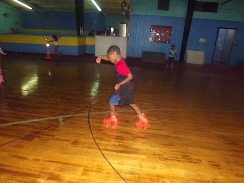 Showing off some moves at the roller rink.