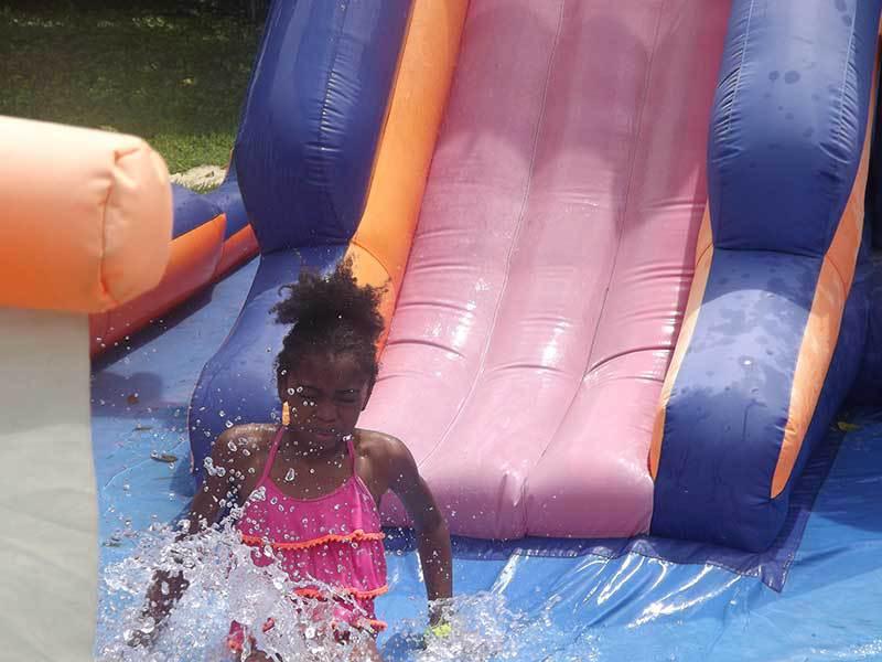 Slip and slide at summer camp.