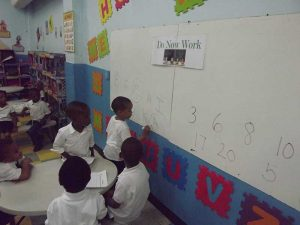 Pre School students working on letters and numbers.